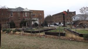 Bistro Herb Garden with Red Man on a Pedestal