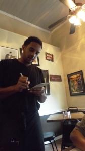 Waiter Derrek and a Framed Satchmo