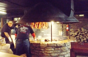 Salt Lick's Pit and Pitmaster.  Ribs and brisket are on the grill.  Sausages are up high.